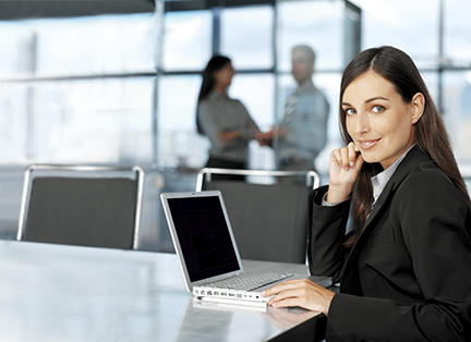 Professional young woman on laptop