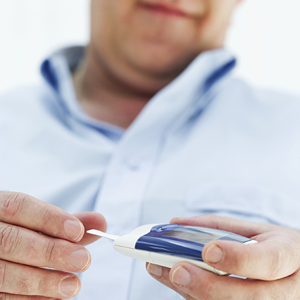 Male with diabetes testing strip