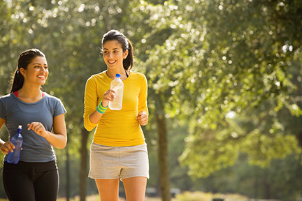 Two females walking in a park