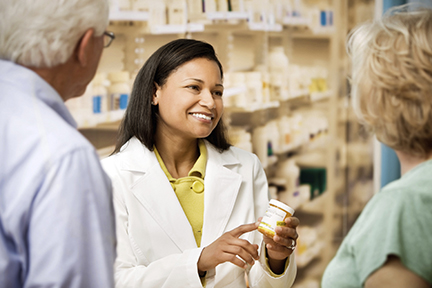 Female pharmacist with a senior couple