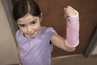 Girl showing her signed cast